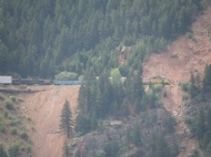 Freight train coming out of another tunnel