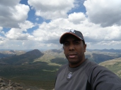 I hate selfies. But it's me on top of Mt. Bierstadt!