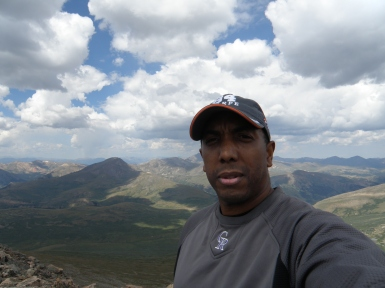 I hate selfies. But it's me on top of Mt. Bierstadt!