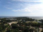 A look south over the town of Corolla, Atlantic Ocean on the left, Currituck Sound on the right.